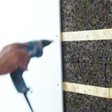 Posa del pannello Cork-self, quarta fase