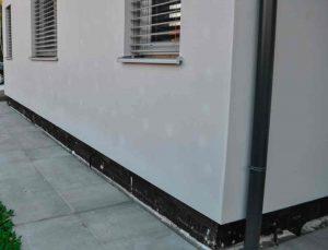 Esempio di tasselli visibili in facciata, su cappotto termico