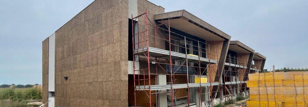 Edificio trifamiliare in xlam e sughero faccia a vista a Mulazzano certificato CasaClima nature